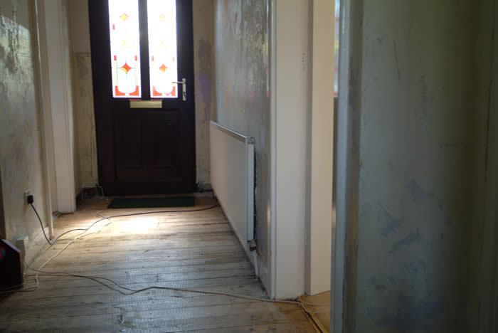 before entrance hall wall panelling