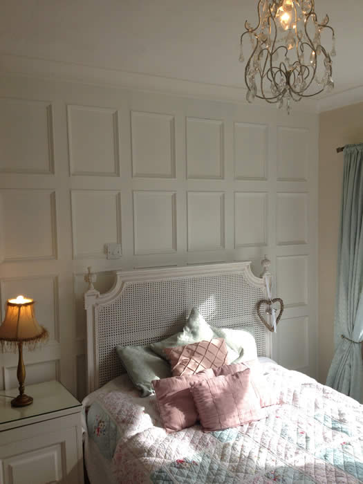 beaded bedroom panelling with french bed acorn cottage south wales