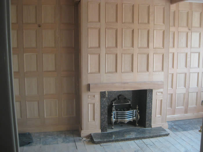 oak wall panelling fireplace by wall panelling experts