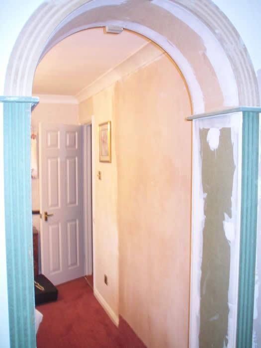archway by wall panelling