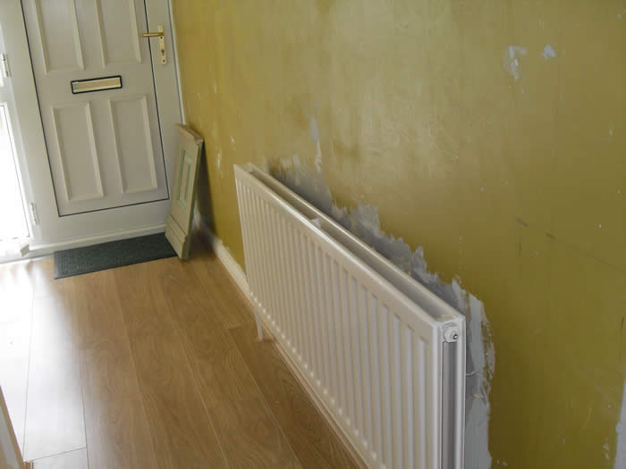 before radiator cabinet and panelling