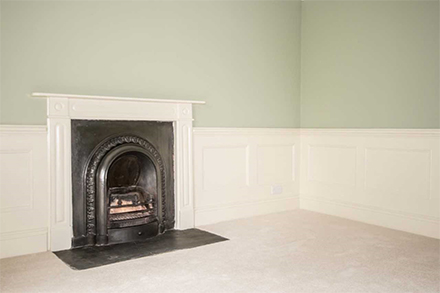 Panelling next to fireplace