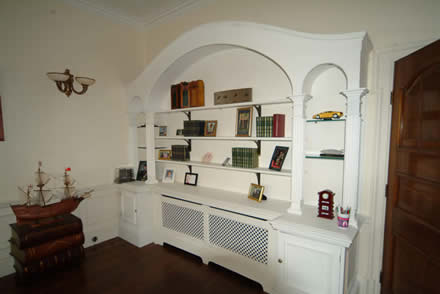 hand made bookcase by wall panelling cheshire