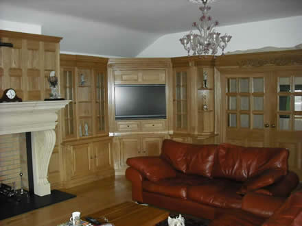 oak media tv surrounds by wall panelling experts made in uk shipped to Guernsey
