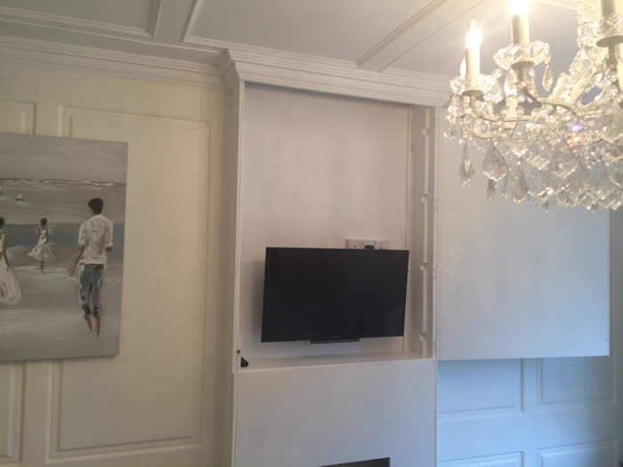 false fireplace with secret panelled cuboard to hide tv