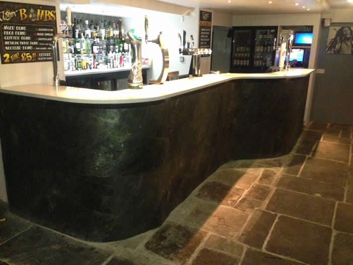curved stone veneer panelled bar