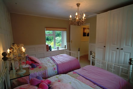 bedroom doors and furniture by wall panelling the secret garden holiday cottage south wales sykes cottages