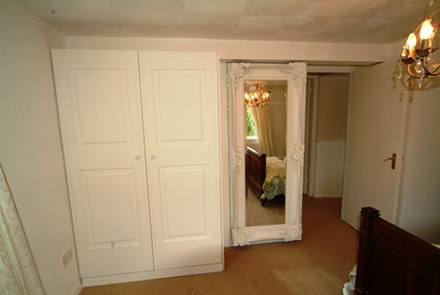 wardrobes and mirror door by wall panelling  the secret garden cottage south wales sykes cottages