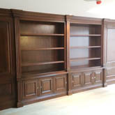 secret oak  panels within wall panelling and bookcase design made in Britian by wall panelling experts