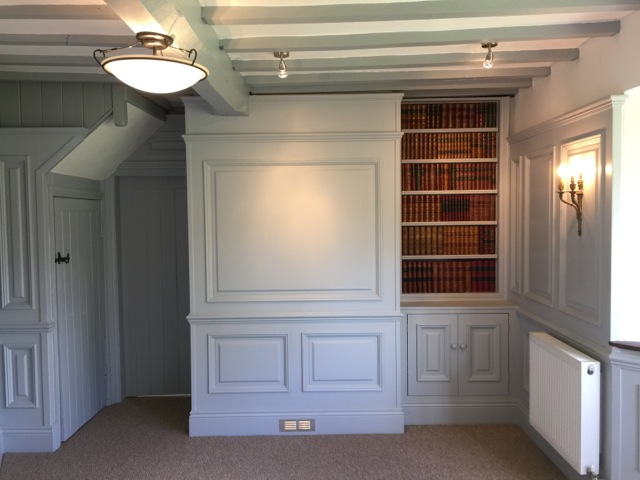 superior panelling with built in bookcase